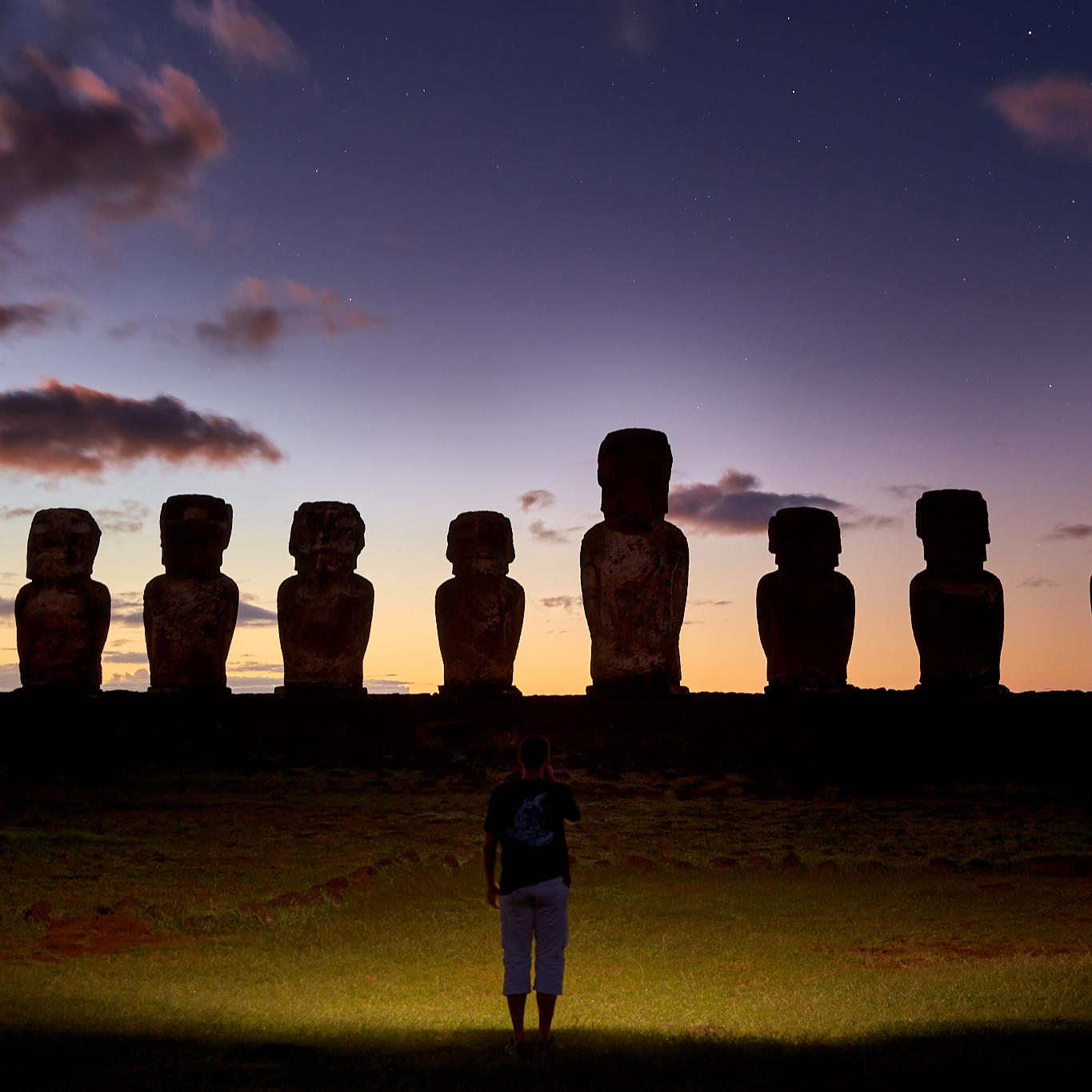 Dawn on Easter island, standing in front of Moai.
